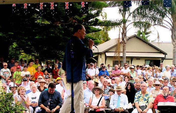 Guest speaker John Bell addresses the crowd